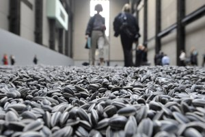 Visitors-walk-through-the-art-installation-Sunflower-Seeds-by-Chinese-artist-Ai-Weiwei-in-London