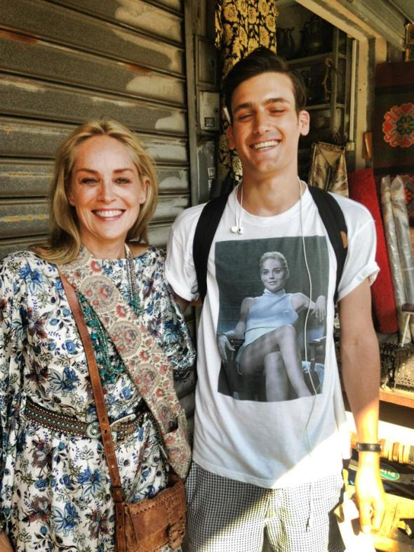 sharon_stone_spots_a_man_walking_along_the_street_in_tel_aviv_wearing_a_basic_instinct_shirt_and_asks_to_take_a_picture_with_him._598559877